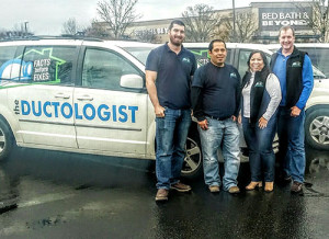 Derrick (far right) and Millicent Rhoades, with crew of The Ductologist