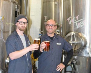 Zane Singleton, left, and Bryan Shull with the tanks at Trap Door Brewing