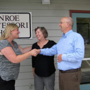Thea Heineman, new owner of Monroe Montessori with former owners Allan and Gayle Washburn